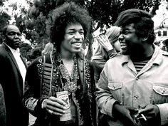 Jimi Hendrix (Lucky Lager) and Buddy Miles, of the all-black badass funky rock trio Band of Gypsys.