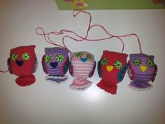 Owls made with baby socks, felt and embroidry floss for mobile. Need to get a pic of the finished project!