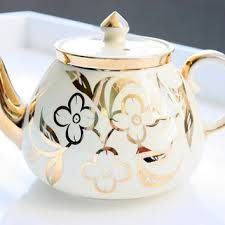 creamy white teapot decorated with gold flowers, rim, spout, knob and handle gilding, c. 1950s-1960s, ceramic