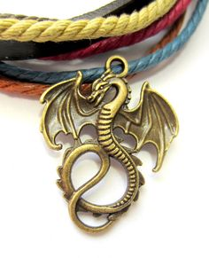10 pc Dragon pendants  antique bronze  winged dragon charms  35mm x 28mm x 2mm hole 2.5mm  nickle safe  K063  Ferocious renaissance dragon charms ...perfect finishing touch for your handmade jewelry, or as an embellishment on a garment..book..bag or even as scrapbook decorations.