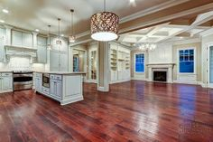 Finished photo of the open kitchen and great room in The Lake George plan by Louisville Custom Builder Stonecroft Homes in Norton Commons. by Stonecroft Homes, via Flickr