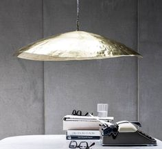 Brass 95 is a suspension lamp by Paola Navone for Gervasoni.