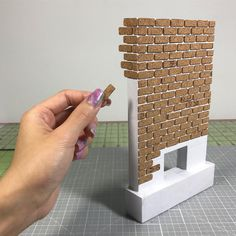 Laying down the cork bricks...slow and steady I almost want to keep this unpainted because the cork adds such a cool effect . . . . . #diyproject #project #decor #fireplace #miniatures #mini #miniature #tiny #cute #crafts #tutorial #craft #crafty #doityourself #design #creative #diy #diydecor #dollhouse #dollcrafts #wood #handmade #wip