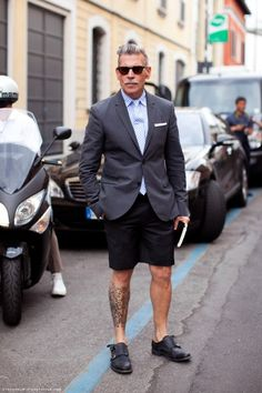 nick wooster. posterboy of classic yet eclectic style. tatts in a tailored suit.