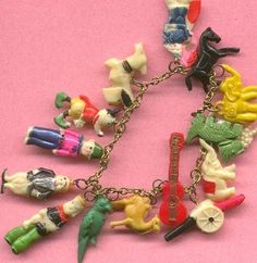 Vintage Childs Charm Bracelet With Celluloid Plastic Cracker Jack Like Charms