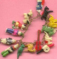 Vintage Childs Charm Bracelet With Celluloid Plastic Cracker Jack Like Charms
