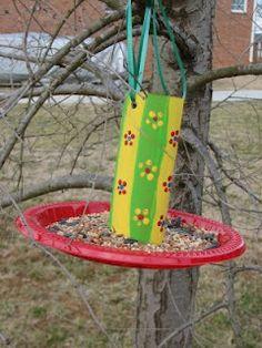 Easy Bird Feeders.  Toilet paper roll + plastic plate.