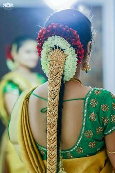 Traditional Southern Indian bride wearing bridal hair, saree and jewellery. #IndianBridalHairstyle