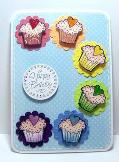 "I made this card for the  Virginia's View challenge at Lily Pad.  The cupcakes are from a 2008 Hero Arts clear set ""Cupcakes"".  Stamping, paper-piecing, Glossy Accents, and faux stitching."