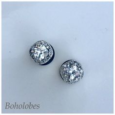 Pair of Square CZ halo stud wedding plugs for gauged or stretched ears. Shown here on size 0g tunnels  Sizes 4g 2g 0g 5mm 6mm 8mm Embellishment is 12x12mm Cubic zirconia clear crystal in silver plated setting PLEASE: read my shop policies https://www.etsy.com/shop/Boholobes/policy before purchasing, and contact me via Etsy messaging before opening any disputes-Thanks so much!  Check out https://www.etsy.com/shop/boholobes for more listings like th...