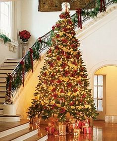 In loveee with the tall tree! I also love the decorated banister behind the tree.