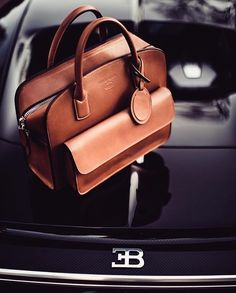 WEBSTA @ blacksnobiety - GIORGIO ARMANI x BUGATTI•Italian fashion label Giorgio Armani and French automaker Bugatti are teaming up to dress the man who seeks luxury in all areas of his life..The first collaboration between the two brands features small leather goods and apparel in colorways and designs that reflect the automaker's aesthetic. Launching for fall/winter 2016, this collection enables both partners to draw on their shared passion for quality and craftsmanship..These pieces, made…