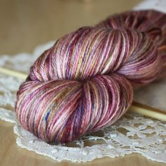 """blackberry bramble"" is one of Phydeaux' most popular colourways with berries, plums, purples and golds, perfect for Autumn knitting. shown here in ""soie,"" 50/50 superwash merino/silk fingering weight yarn (so so softy and silky). hand dyed by phydeaux designs - click through the photo for more details!"