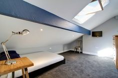 Attic room with plush carpet. 8 Furness Road 6 Bedroom Manchester Student House Bedroom 12.