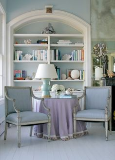 Pretty upholstered chairs for seating in front of bookshelves