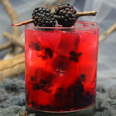 A blackberry cocktail made with vodka, lime juice, fresh blackberries, and a splash of anise flavored Ouzo for a unique flavor.