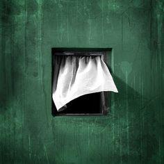 Green wall,white curtain