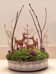 Deer family wedding cake topper. I made this too! It was perfect to represent us as a family (myself, my husband, and our two year old son).