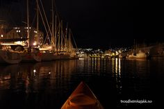 view to Skansen channel from kayak at night