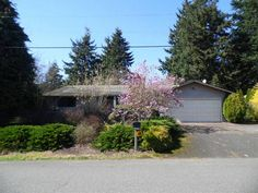 Front view of the home. #FrontDoorRealty #FrontDoorNW #HomesForSale #PDX #Portland #PortlandOR #PortlandHomesForSale #OregonHomesForSale #OneLevelHomes #RealEstate #PortlandORRealEstate #RealEstateForSale #Auction #AuctionProperty #AuctionHomesForSale