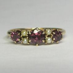 Laura's lifeintheknife on Ruby Lane: Antique Victorian 10K Seed Pearl  Garnet Doublet Ring