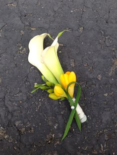Mini calla Lilly and yellow freesias boutonniere.  Can also invert the colors to yellow calla lily with white freesia to match the bouquet!