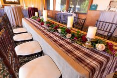 Wintery holiday tablescape with our Manchester Plaid white, dark red, and tan Wide Runner atop a floor length Stone Linnea natural linen at Tannenbaum Event Center