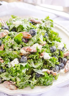 Kale, Blueberry, Goat Cheese and Candied Pecans Salad -- Clean Eating salad with homemade poppy seed dressing. #glutenfree #vegetarian
