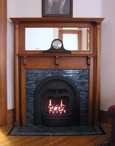 """Valor 530ICN """"Coal Fire"""" Radiant Gas Fireplace and Insert. Installed with Windsor Arch with Tiled Surround in Antique Mantel. To learn more visit: www.valorfireplaces.com"""