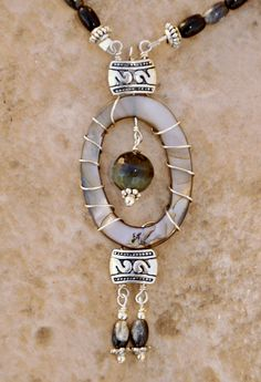 Faceted tiger eye drop in a mother of pearl frame - Necklace. $40.00, via Etsy.