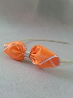 Don't throw your scrap ribbon pieces away. You can still make something out of it like this lovely bow. All you need is a few pieces of ribbon to make this cutebow for a headband.  Materials ribbons headband needle and thread fabric glue scissors