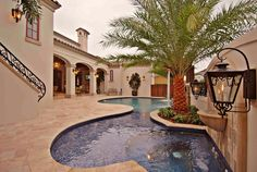 Mediterranean Swimming Pool with Gate, Casement, Painted stucco exteriors, Fountain, Bird bath, exterior stone floors, Fence