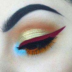 maroon electric blue aqua gold orange eyeshadow makeup look
