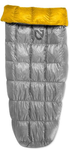 Nemo Siren Down Ultralight Quilt. One of the lightest quilt-style sleeping bags on the market constructedusing the highest end fabrics and 850FP down. Stretch footbox anchors bag topad and accommodates a variety of pad widths. Side tie loops, drawstring opening, and collar snap keep you tucked in and minimize drafts on cold nights. Insert your pad inside Siren or snuggle on top. 850 fill power down clusters trap layers of air for natural insulation while high loft ensures warmth and...