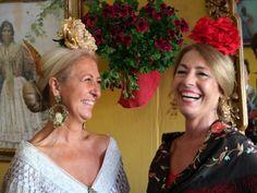 Cuñadas (sisters-in-law) Ana Andaluz Domínguez and Mari Carmen Onrubia de Esquivias, Casetita de los Nietos de Don Manuel share a laugh, la Feria de Abril de Sevilla, April 14, 2016.  Photo by Gerry Dawes©2016, Canon M3