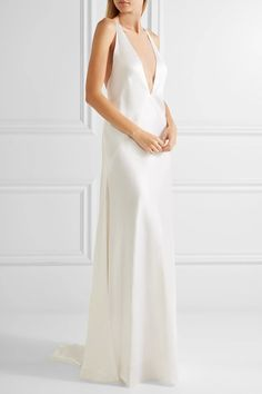 White silk-satin Slips on 100% silk Dry clean Designer color: Optical White ImportedLarge to size. See Size & Fit notes