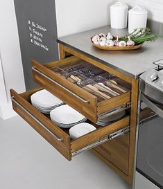 Drawers for plates under silverware