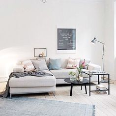 Soft grey sofa creates gorgeous scandi vibes in this living room