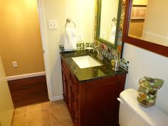 61.Hall bath vanity with granite top matching with wall cabinet. Surplus building materials Austin TX.