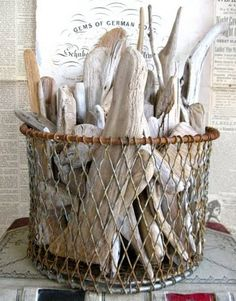 A bundle of driftwood looking great in a vintage wire basket.  #driftwood #wirebasket