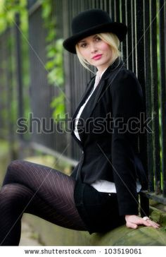 Pretty Young Business Woman Posing Outdoors Stock Photo (Edit Now) 103519061 Female Poses, Female Portrait, Photo Poses, Photo Shoot, Photo Tricks, Corporate Portrait, Business Headshots, Bowler Hat, Outdoor Photos