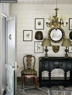 classic, masculine entry in white, black, brass