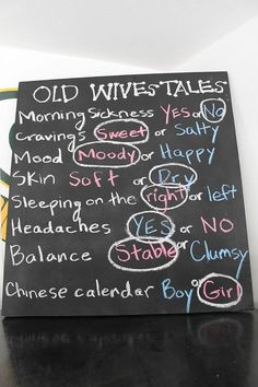 Pink and blue gender reveal old wives tales on chalkboard