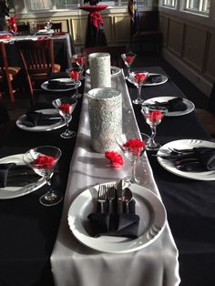 Beaufort Weddings - Black, red and white table settings with silver glitter candle holders as center pieces from a wedding at Traditions in Beaufort, SC.