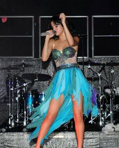 Selena preforming during her we own the night tour