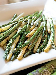 1. *If white asparagus is not available, use 2 pounds green asparagus. 2. Preheat oven to 450 degrees. 3. Snap off tough ends of asparagus; discard tough ends. 4. Line a 15-x-10-x-1-inch jellyroll pan with aluminum foil. Place asparagus in a single layer on foil. 5. In a small bowl, combine oil, garlic, salt, and pepper; drizzle over asparagus. 6. Bake for 8 to 10 minutes, or until crisp-tender. Remove from oven; drizzle evenly with vinegar.