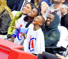 Kevin Hart, fiancee Eniko Parrish, and his adorable kids Heaven and Hendrix were having the best time ever as the Memphis Grizzlies played the Los Angeles Clippers at the Staples Center in L.A. Feb. 23.