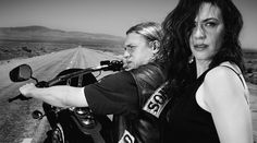 Jax and Tara from Sons. Tara in the forefront as she develops her character to take Jemma's throne as Biker Matriach - behind Jax on the bike, but clerly leading the journey they are about to embark on. The road open ahead and the markings like a yellow brick road. The modern Femme Fatale.