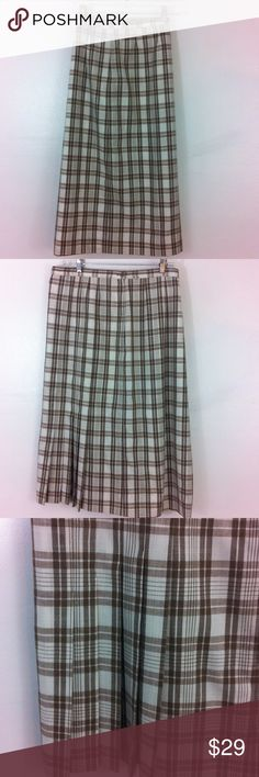 """vintage plaid skirt by Country Sophisticates. Country Sophisticates is a division of Pendleton and made in Portland . This is a cool brown plaid skirt that is lined. Side button and metal zipper. No give in this fabric. Tag size 22. Waist  39, hips 50 and length 31"""". One section off to side bottom is pleated for easy movement and a sleek look. Country Sophisticates Skirts"""