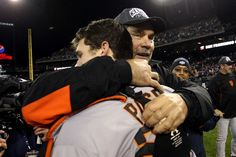 DETROIT, MI - OCTOBER 28:  Manager Bruce Bochy #15 of the San Francisco Giants hugs Buster Posey #28 after defeating the Detroit Tigers to win Game Four of the Major League Baseball World Series at Comerica Park on October 28, 2012 in Detroit, Michigan. The San Francisco Giants defeated the Detroit Tigers 4-3 in the tenth inning to win the World Series in 4 straight games.